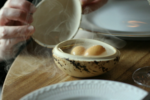Smoked and pickled quails egg