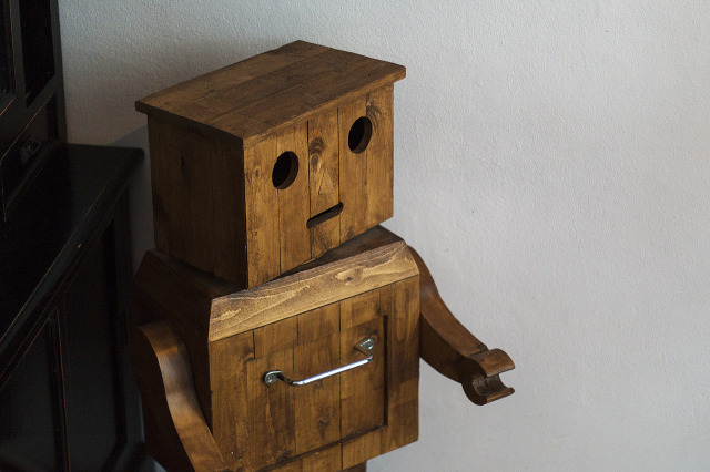 The wooden robot greets you